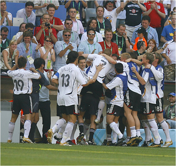 The Germans celebrate after scoring in front of their fans in Munich.