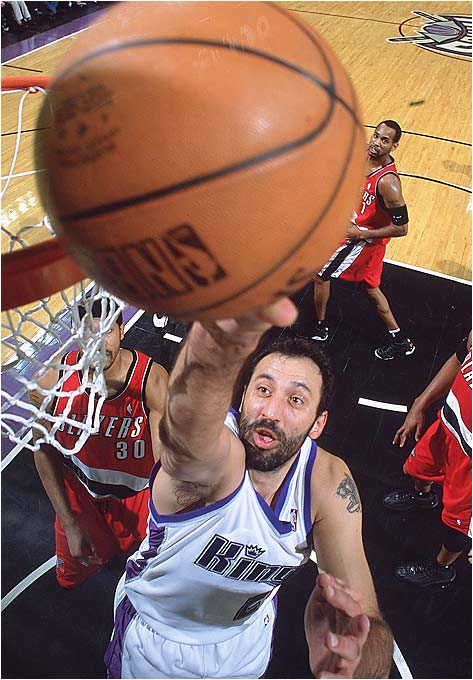 Vlade Divac, SerbiaLos Angeles Lakers, 1989, first round, 26th overall A late-first-round curio who grew into one of the better centers of his generation, Divac found the perfect setting for his skills and considerable charisma in Los Angeles. He grew from a backup to Mychal Thompson, to the starter on the 1991 Western Conference champions, to the team's franchise player in its lean, post-Magic Johnson years. Sent to Charlotte in '96 (for the draft rights to Kobe Bryant), Divac continued his stellar play in two playoff-bound campaigns for the Hornets and became the free agent prize of the Sacramento Kings in early '99. Divac's interior brilliance and locker-room guidance created the turning point for a Kings team that had made the playoffs only twice in its franchise history. Divac lead the team to six straight playoff appearances before one last go with the Lakers in 2004-05, and retirement last summer.