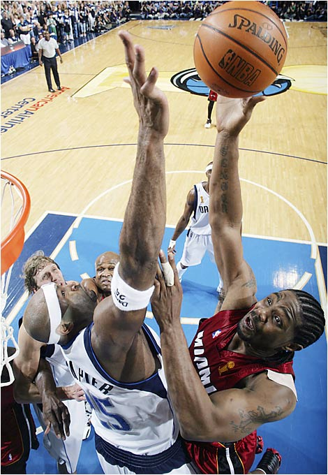 Udonis Haslem was seemingly everywhere in Game 6, including all over Erick Dampier. The former Florida Gator managed a double-double (17 points and 10 rebounds), digging out key points in the waning minutes to keep Dallas at bay.