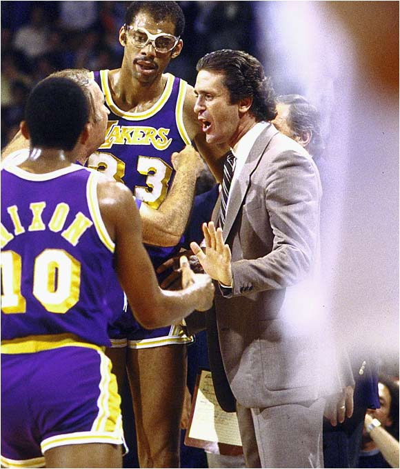 Though he went 50-21 and led the Lakers to the NBA title after taking over for Paul Westhead 11 games into the 1981-82 season, Riley's first full season was 1982-83. L.A. had a 58-24 mark that year and was swept by the Dr. J and the Sixers in the NBA Finals.