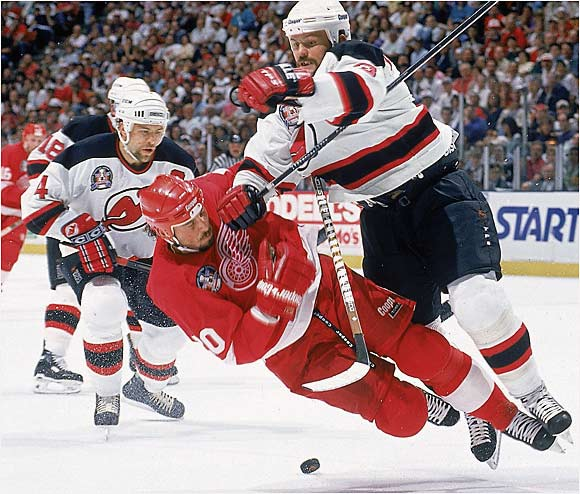 After a strike-shortened season, the Red Wings were expected to sweep to the Cup, only to have the table turned on them by coach Jacques Lemaire's defense-minded Devils. Claude Lemieux won the Conn Smythe by scoring 13 playoff goals while rugged backliners such as Ken Daneyko (nailing Martin Lapointe in this photo) and goaltender Martin Brodeur never gave the Wings a chance to get into a groove. Neal Broten capped the Devils' rise to NHL power by scoring the franchise's first Cup-winner.
