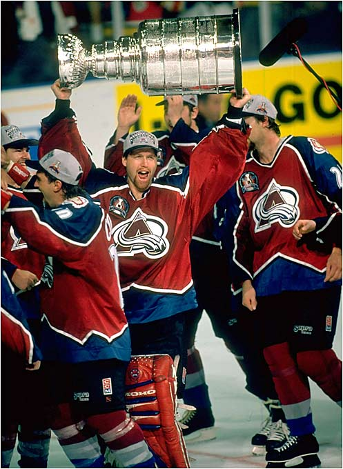 The former Quebec Nordiques gave Colorado its first major pro championship in its first season in Denver. Conn Smythe-winner Joe Sakic scored 18 goals and goaltender Patrick Roy (with Cup) was money. Coach Marc Crawford's Avs' battled past Detroit in the Western Conference Final, sparking a bitter rivalry when Claude Lemieux devastated the Wings' Kris Draper with a hit in Game 6. Colorado swept the upstart Panthers as defenseman Uwe Krupp scored the Cup-winner at 4:31 of triple OT in Game 4.