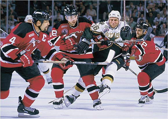 Defenseman Scott Stevens was a one-man wrecking crew, dispensing crushing hits and bagging the Conn Smythe Trophy as coach Larry Robinson's Devils denied the Stars a repeat.  Martin Brodeur allowed only four goals in the final four contests -- Dallas needed triple overtime to win Game 5 -- and Jason Arnott finished off the Stars in double OT of Game 6, with an assist by Stevens.