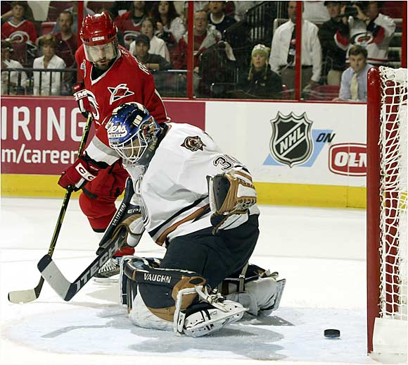 After Edmonton's workhorse netminder Dwayne Roloson was injured in Game 1, Jussi Markkanen was thrown into the fire in Game 2. It was his first start since March, and he was burned for five goals, this one by Mark Recchi.