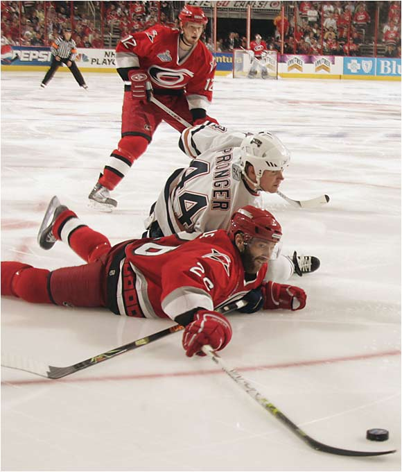 The Hurricanes were inspired by the dramatic Game 6 return of Erik Cole, seen here being taken down by Edmonton's Chris Pronger in Game 7. Cole was not expected to play again this season after suffering a serious neck injury in early March.