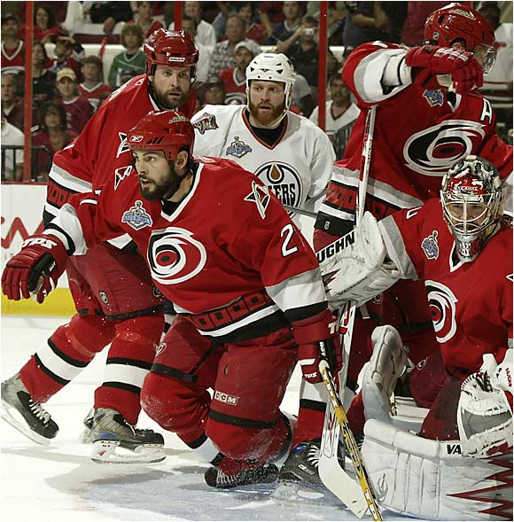 When the game went to overtime, the Oilers pressed their attack, putting seven shots on Carolina's net, which became a gathering place for Cam Ward's red-shirted protectors.