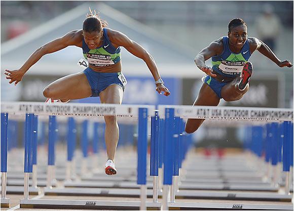 Virginia Powell, left, won the 100 meter hurdles in 12.63