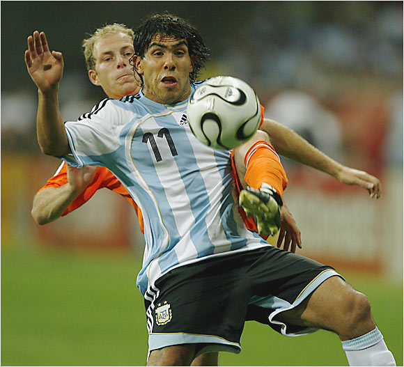 Carlos Tevez (11) made his World Cup debut as Argentina played the Netherlands to a 0-0 draw.