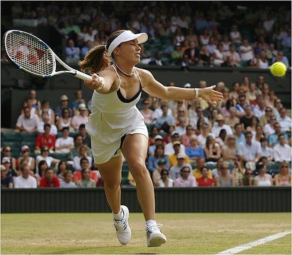 Playing at Wimbledon for the first time since 2001, Martina Hingis lost to No. 18 seed Ai Sugiyama of Japan, 7-5, 3-6, 6-4 in the third round.