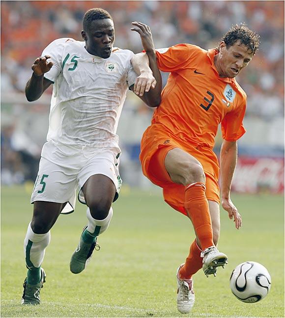 The Netherlands' Khalid Boulahrouz (right) fends off the Ivory Coast's Aruna Dindane during Friday's match at Gottlieb-Daimler Stadium