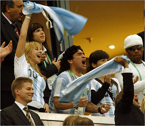 Venerable Argentinean soccer star Diego Maradona cheers on his team from the stands. Maradona captained Argentina to the championship in 1986.