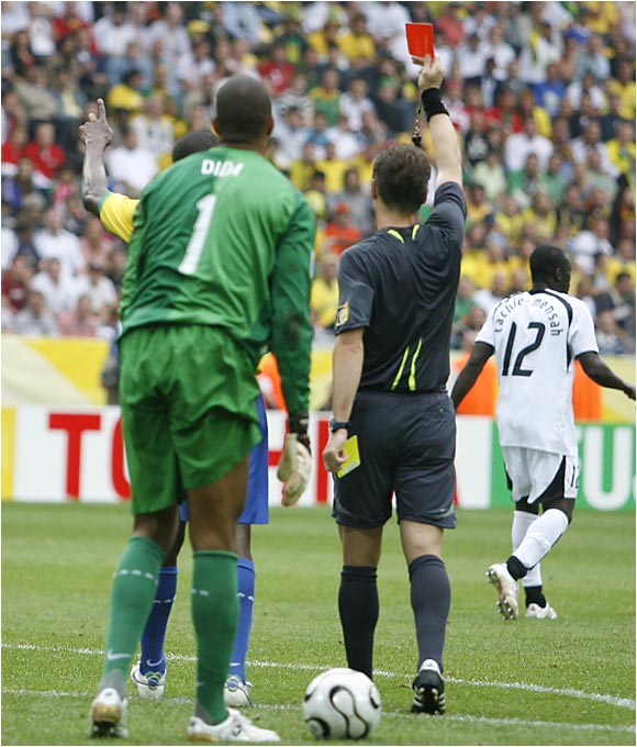 Ghana's Asamoah Gyan was given a red card by the referee for diving, his second yellow card of the match. The red card was the 25th of the tournament, a World Cup record.
