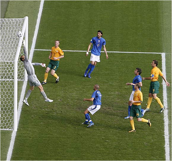 Australia's Mark Schwarzer reaches up and makes a save during the Aussies' 1-0 defeat to Italy.