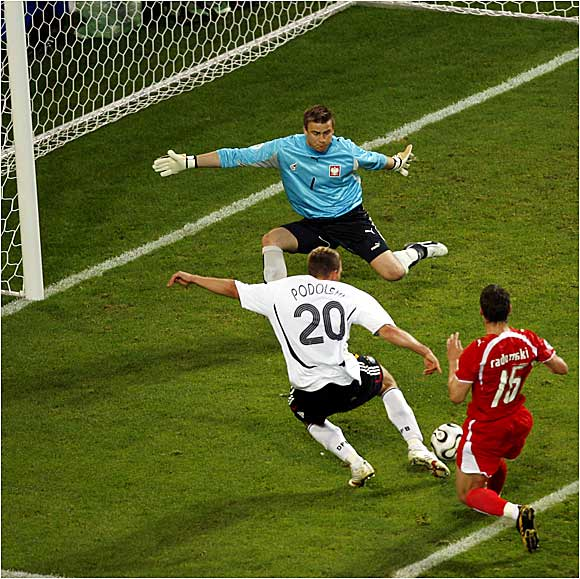 Poland's goalkeeper Artur Boruc makes one of his sensational saves against a relentless offensive assault from the host country. Germany out shot its opponent 17-4.