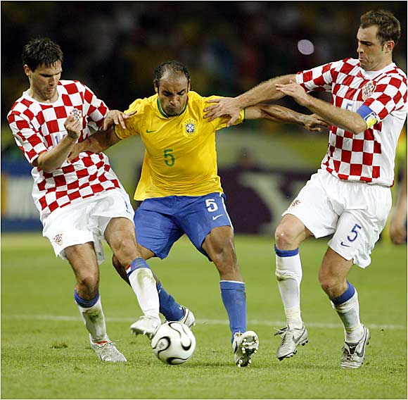 Croatia's Igor Tudor (right) and Jerko Leko sandwiched Brazilian midfielder Emerson. Brazil, the defending champion, won a tournament-record eighth straight game Tuesday, defeating Croatia 1-0 in Berlin.