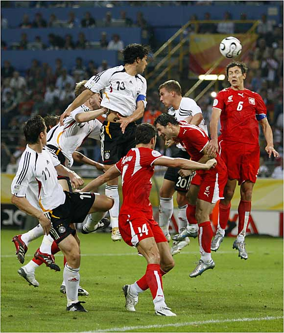 Midfielder Michael Ballack (13) and defenseman Jacek Bak (6) vie for a header during Germany's thrilling 1-0 victory over Poland Wednesday night in Dortmund.