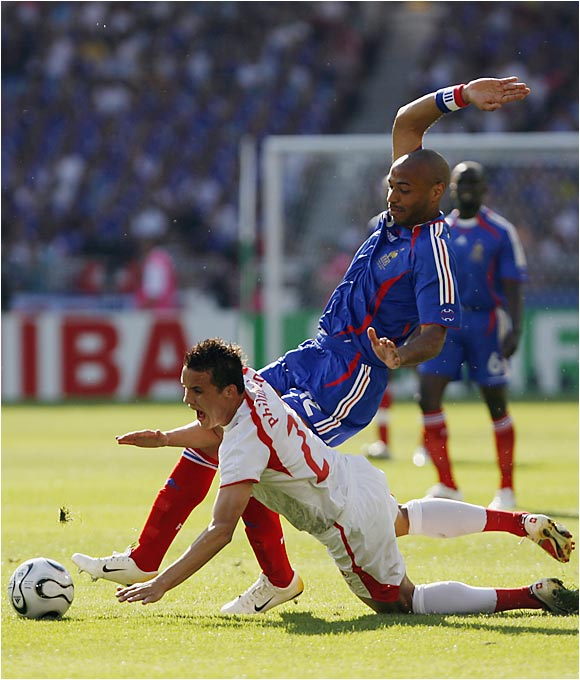 Superstar forward Thierry Henry (blue jersey) and his teammates will have to find their offense by Sunday when they face South Korea, which can advance to the second round with a win.