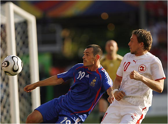 Willy Sagnol Daniel (left) and Gygax Swiss fight for possession during Tuesday's game between France and Switzerland at Gottlieb-Daimlerstad stadium.