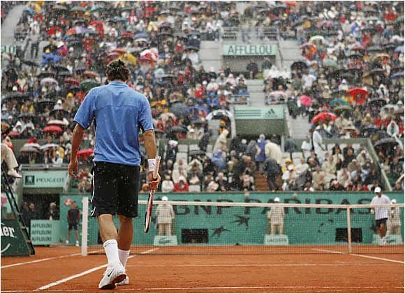 Despite two rain delays and damp, chilly weather, No. 1 seed Roger Federer easily disposed of Alejandro Falla of Colombia 6-1, 6-4, 6-3.