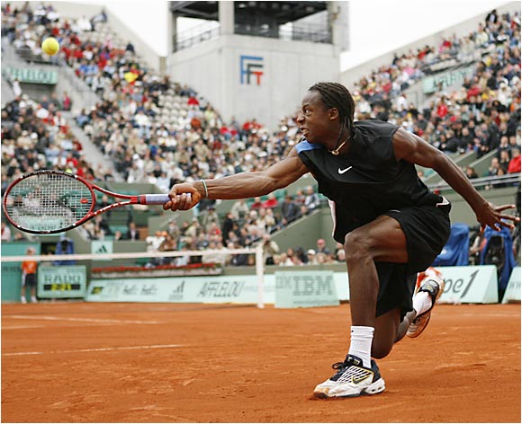 Nineteen-year-old Gael Monfils defeated the oldest man in the French Open field, Dick Norman, 35, to equal his best showing at a Grand Slam.