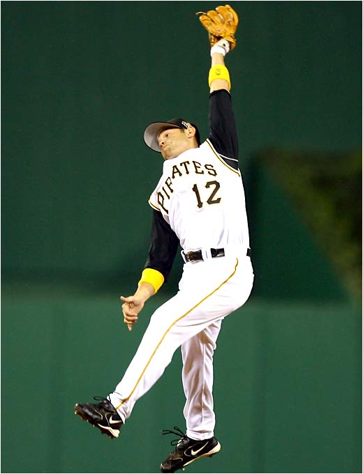 Freddie Sanchez of the hometown Pittsburgh Pirates gets full extension to snag a Mark Loretta liner in the fifth inning.