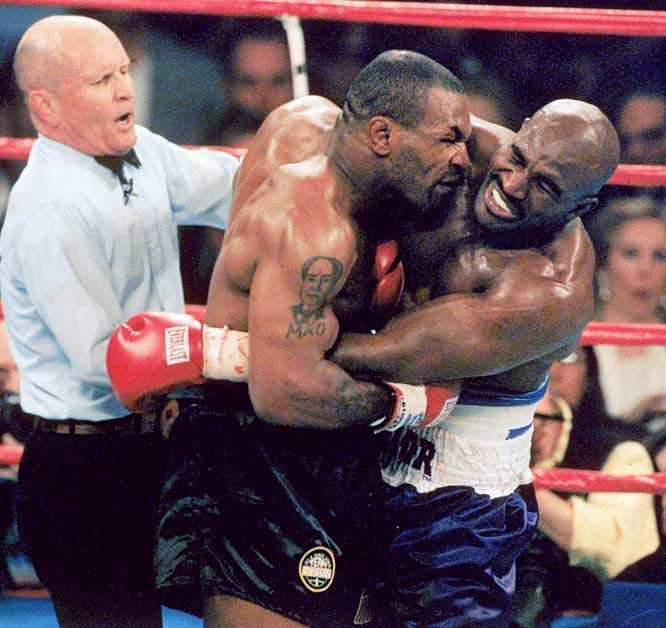 "Mike Tyson's match against Evander Holyfield on June 28, 1997, was promoted as ""The Sound and Fury."" And it was Holyfield who wound up furious after Tyson bit both of his ears. Saying that the biting was the only reasonable reaction to Holyfield's unregulated head butts, Tyson was disqualified by referee Mills Lane at the end of the third round."