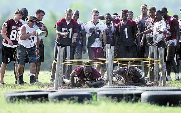 Mississippi State strength coach Mark Grant had the right idea when he had the Bulldogs get down and dirty in the summer of 2001. He set up a boot camp and had his troops crawl through mud, up ropes and sweat in the 100 degree heat. The Bulldogs weren't the most talented team in the SEC, but no team had more bite.
