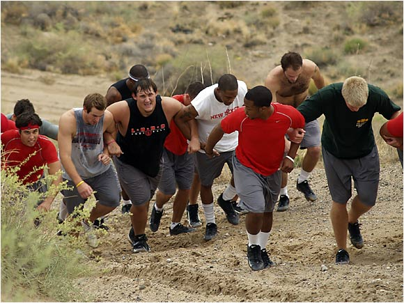 As if New Mexico's infamous Pit wasn't daunting enough, members of the Lobos' football team partake in grueling conditioning by sprinting up sand pits this summer. Those who struggle are aided up the hill by their teammates.