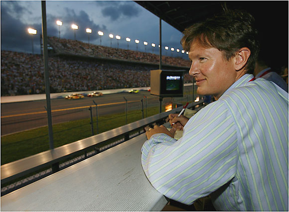 Sports Illustrated NASCAR writer Lars Anderson takes in the Pepsi 400 from near track level.