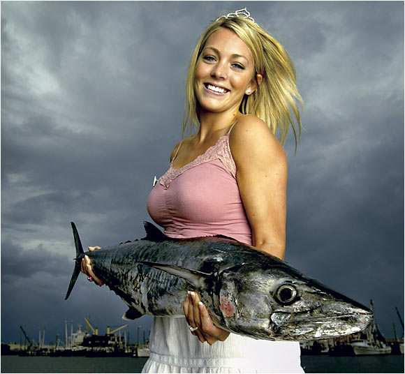 Chelsea Diane Welch holding a King Mackerel, also known as the Kingfish, in Gulport, MS on July 5, 2003.