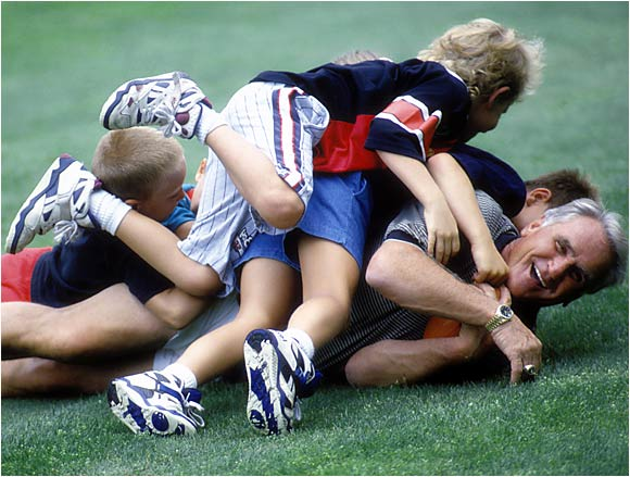 Miami Dolphins coach Don Shula at home playing with his grandchildren. July 4, 1993.