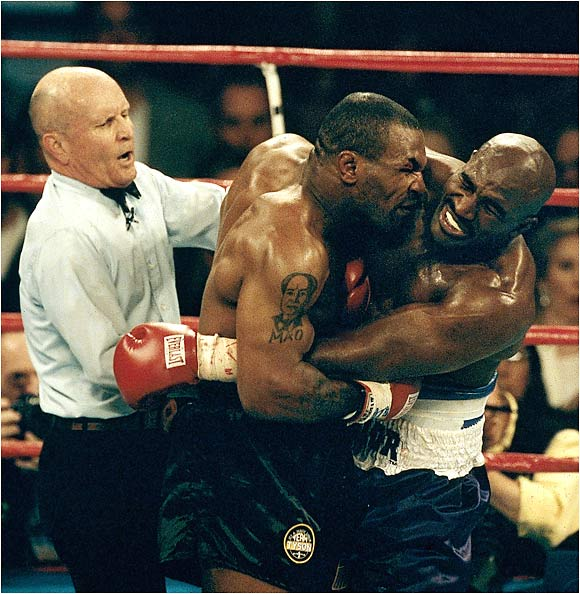 Tyson-Holyfield II proved to be one of the most gruesome moments in sports. With 40 seconds to go in the third round, Tyson wrapped up Evander Holyfield, spit out his mouthpiece and then bit off a chunk of Holyfield's right ear, leaving an arena in awe. Tyson was disqualified.
