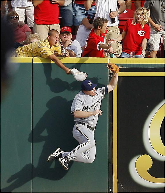 Milwaukee center fielder Gabe Gross leaps against the wall and makes a sensational catch during Cincinnati's 8-7 victory over the Brewers at Great American Ball Park.