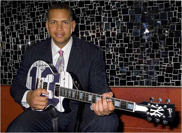 Yankees superstar Alex Rodriguez poses with a new custom Gibson guitar at a party at Pascha nightclub thrown by Gotham Magazine. The one-of-a-kind ax would later be auctioned off for charity.