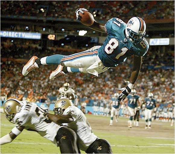 """The Flying Dolphin"" Randy McMichael dives for a touchdown against the Saints on Aug. 15, 2002."