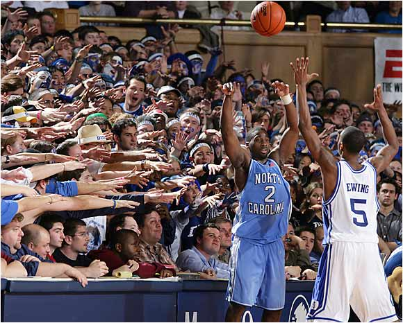 Duke's Cameron Crazies taunt North Carolina's Raymond Felton on Feb. 9, 2005.