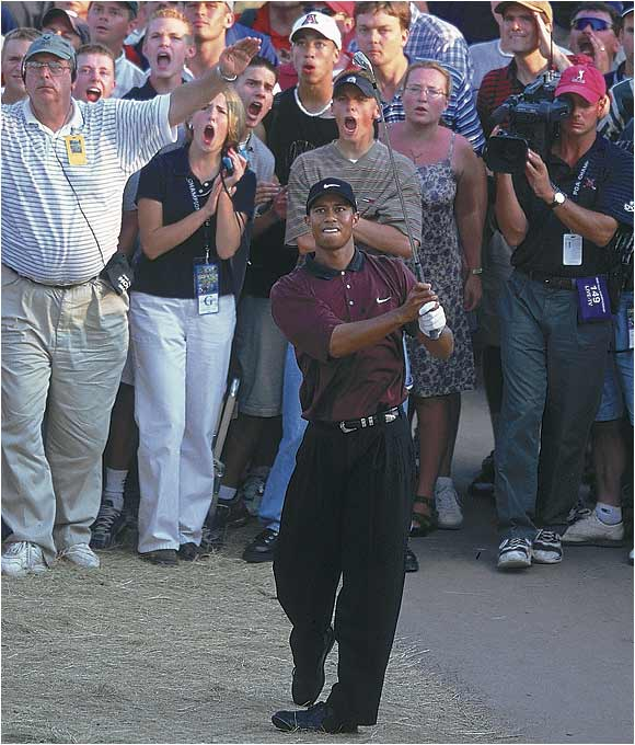 Fans and media watch intently as Woods hits his second shot on the third playoff hole at Valhalla. The crowd at the course (which Jack Nicklaus personally designed) was treated to one of the most compelling endings in PGA Championship history.