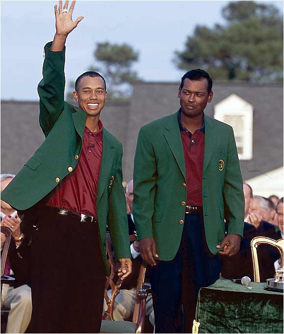 Is it envy or awe going through Vijay Singh's mind as he watches Woods acknowledge the crowd after his win? With the victory, the 25-year-old Woods became the only golfer in history to hold all four major titles at the same time.