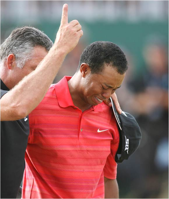 "Tiger, having lost his dad to cancer earlier in the year, kept his emotions in check all week at Royal Liverpool -- until he clinched the win. Then he broke down, with caddie Steve Williams lending a comforting shoulder. ""I just wish he could have seen it one more time,"" Tiger said of his dad."
