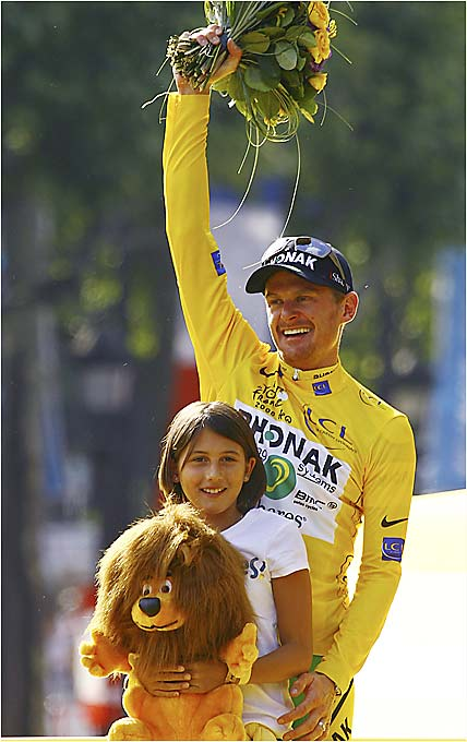 """I kept fighting, never stopped believing,"" Landis said shortly after he received the winner's yellow jersey on the podium, joined by his daughter, Ryan."