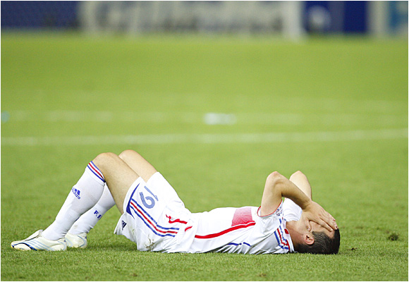 Willy Sagnol lies on the ground dejected after Italy ended France's bid for a second World Cup title.