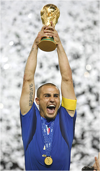 Fabio Cannavarro, who played every minute of the World Cup for Italy's defense, hoists the FIFA World Cup Trophy.