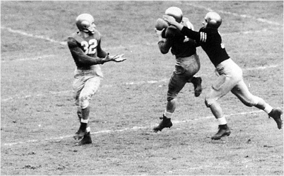 "The lone quarterback in college football history to direct three national titles, Lujack (32) was equally esteemed as a defender. His defining play was an open-field stop of Army's Heisman Trophy winner Felix ""Doc"" Blanchard during the famous 0-0 clash in 1946 against the two-time defending national champs. The 1947 Heisman Trophy winner was the centerpiece of Notre Dame's Golden Age of Football after World War II, when the Irish never lost from 1946-49. In 1960, Lujack became the youngest player (age 35) to be inducted into the College Football Hall of Fame."