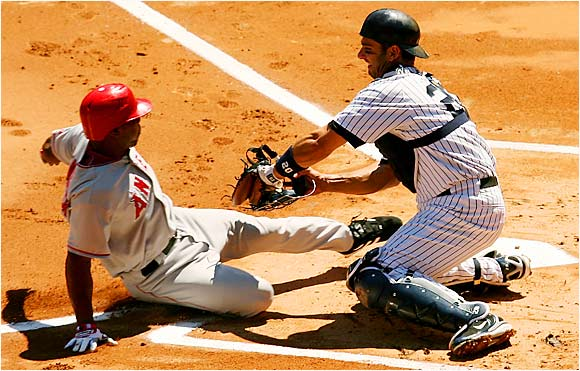 Howie Kendrick of the Angels is tagged out by Yankees catcher Jorge Posada in the Bronx on Aug. 13.  Despite preventing a run, the Yankees were defeated 5-3, dropping two out of their last three to the Angels.