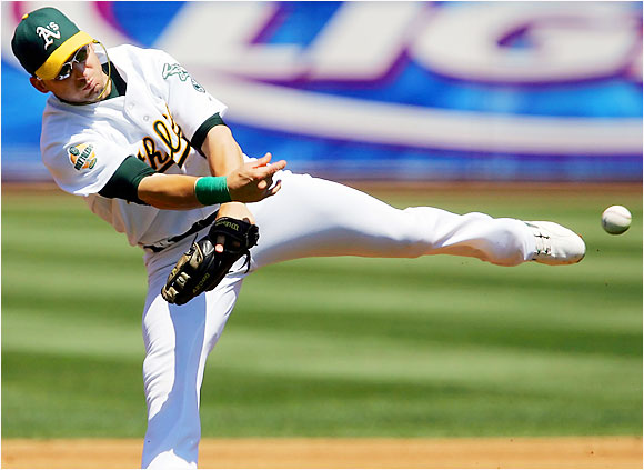 A's shortstop Marco Scutaro's off-balance throw to first base wasn't in time to catch  the  Rangers' Mark DeRosa. The Rangers went on to beat the Athletics 14-0.