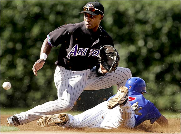 The Cubs' Ryan Theriot is safe stealing second ahead of the throw to Orlando Hudson in the first inning of Game 2 of a doubleheader with the Diamondbacks on Aug. 3. The Cubs managed to steal the second game 7-3 after losing the first 10-2.