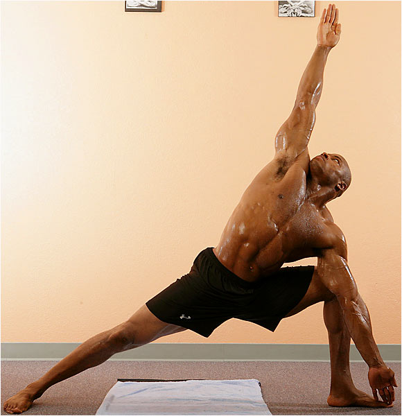 Posture: Stand straight with arms overhead. Step right leg out to right four feet with arms outstretched, parallel to floor. Turn right foot towards the right and bend right knee until thigh is parallel to floor. Keeping arms straight, bend torso directly to the right. Place fingertips of right hand on the right big toe with elbow flush against knee. Left arm straight up towards the ceiling, palm facing forward. Turn head to look at hand. Hold for 10 counts. Return to lunge position. Step back to start position and switch legs.