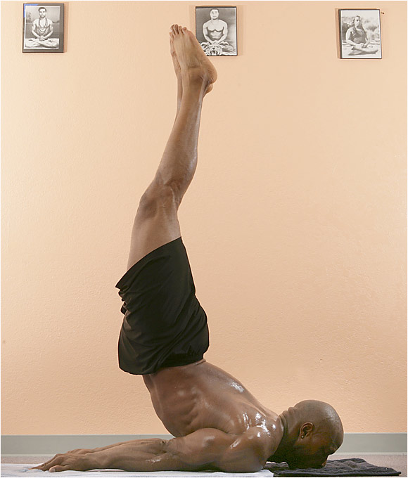 Posture: Lie on belly with chin on mat. Put arms underneath body, palms on floor. Raise right leg as high as you can, behind you. Hold for 10 counts. Return to starting position and switch legs. Return to starting position and raise both legs and hips off floor as high as you can (as shown) and hold for 10 counts. Lower legs and rest on stomach. 20 seconds, face to one side. Repeat all three positions.