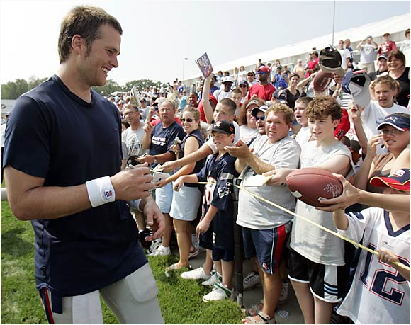 Tom Brady laughs while signing autographs for hundreds of fans. It's nothing new for the Patriots QB, who has led New England to three championships in the last 5 years.