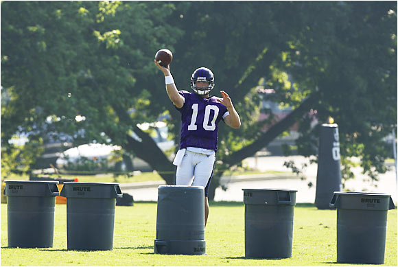 Ravens rookie quarterback Drew Olson lines up behind five rubbish bins during a drill in Westminster, Md. The former UCLA Bruin is competing with  Kyle Boller and Brian St. Pierre for a backup job behind Steve McNair.